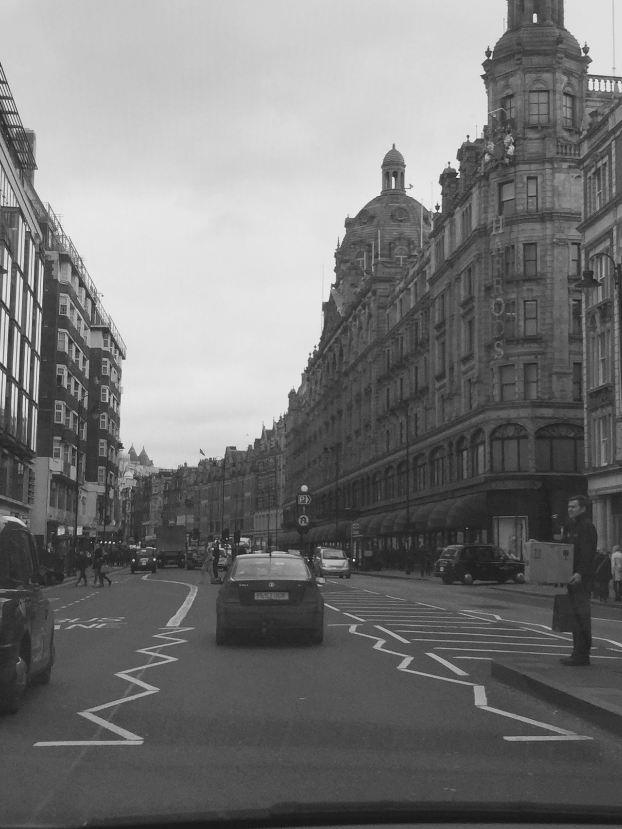 Low Section Outdoors Day Real People Building Exterior Street City Flagship Store Architecture Built Structure Road City Street Transportation Car The City Light Blackandwhite Photography