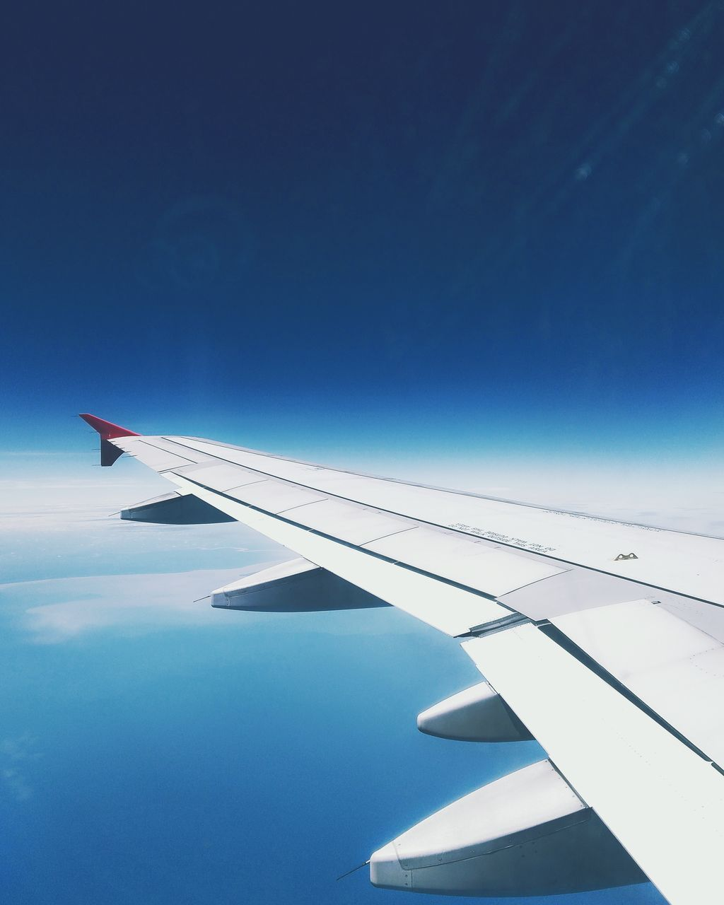 airplane, transportation, blue, journey, no people, mode of transport, sky, airplane wing, travel, aircraft wing, nature, air vehicle, day, aerial view, flying, outdoors, beauty in nature
