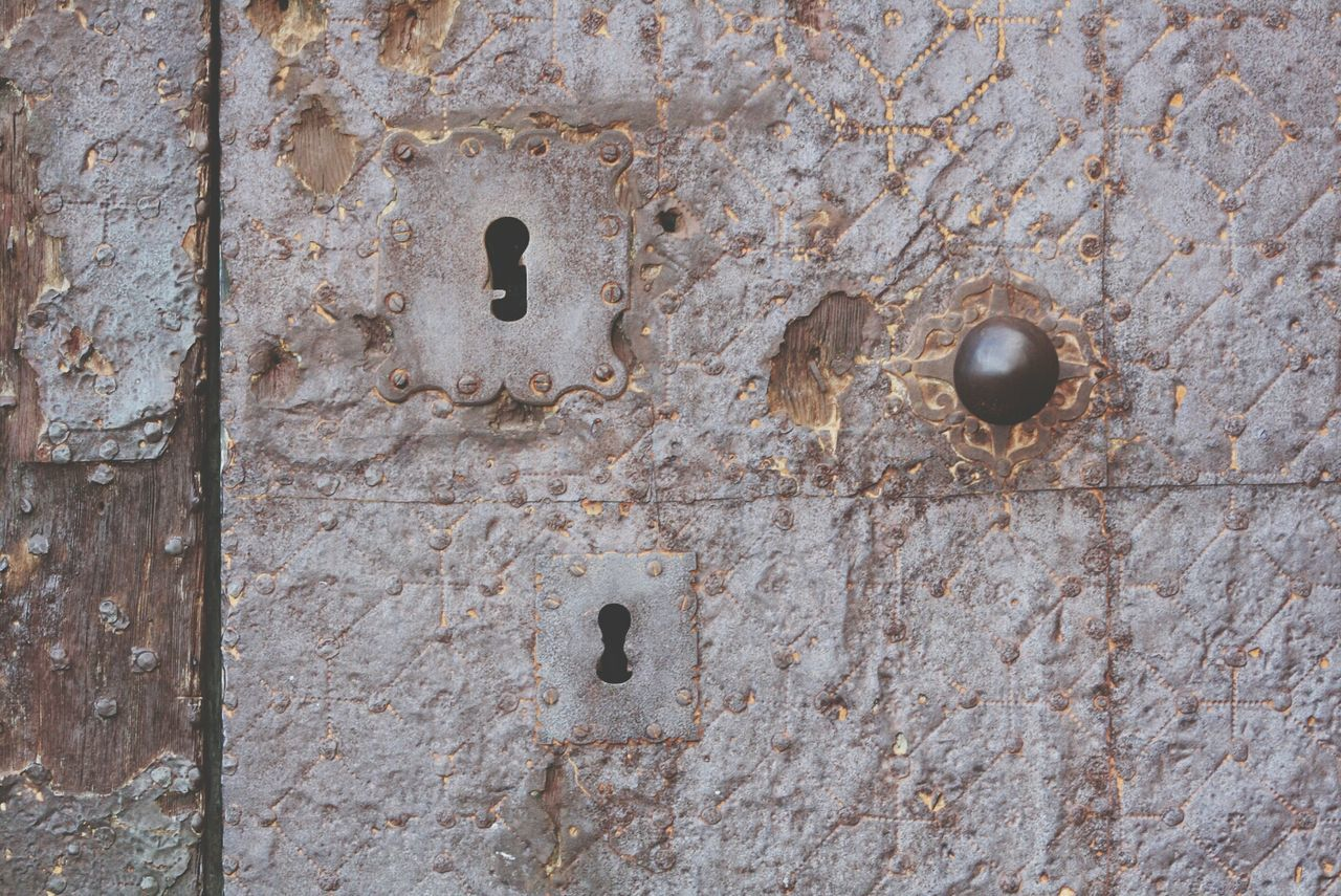 Extreme close up of door knob and keyholes