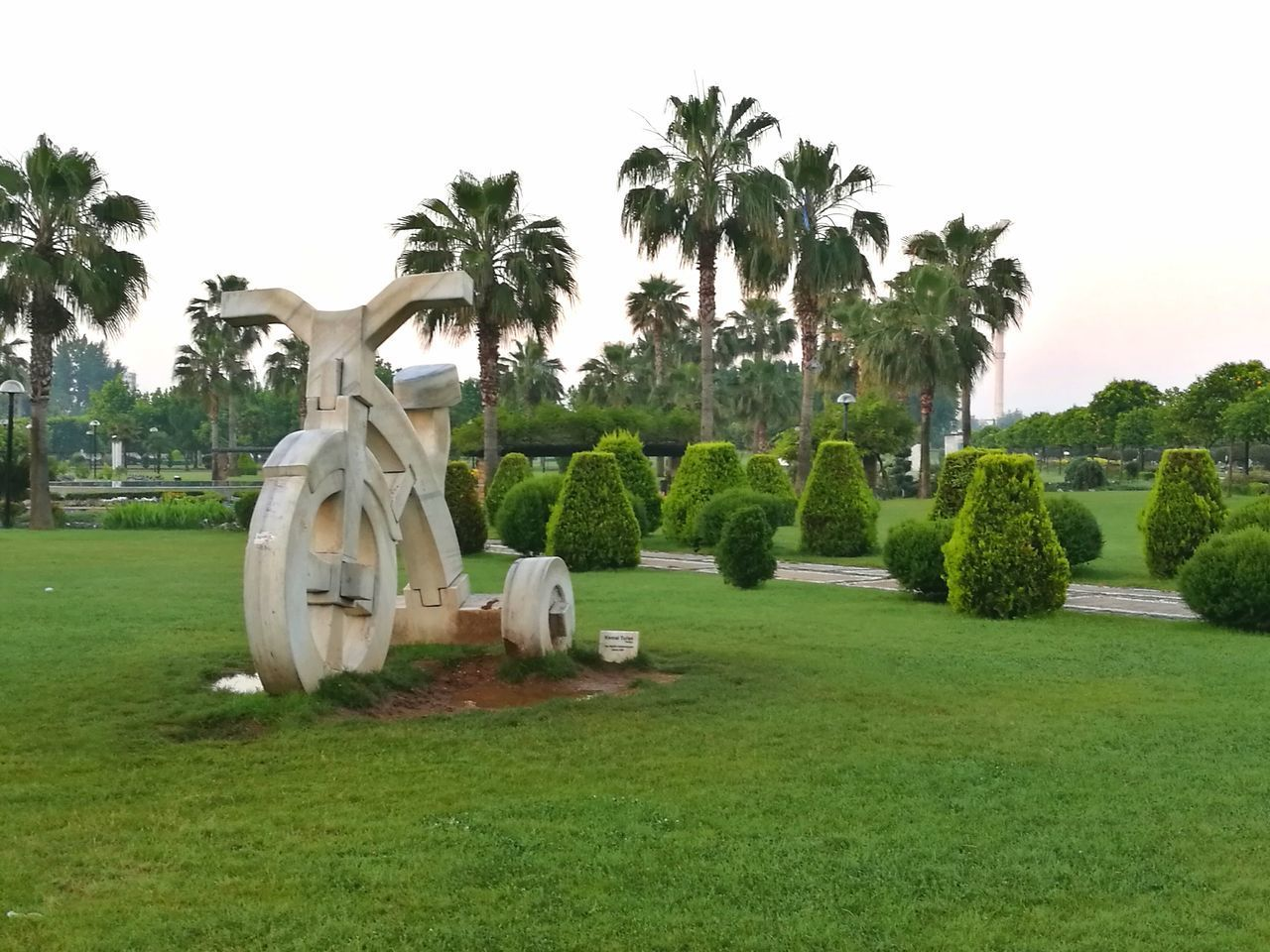 tree, grass, palm tree, outdoors, day, no people, sky, nature, landscape, statue, clear sky, golf, golf course, green - golf course