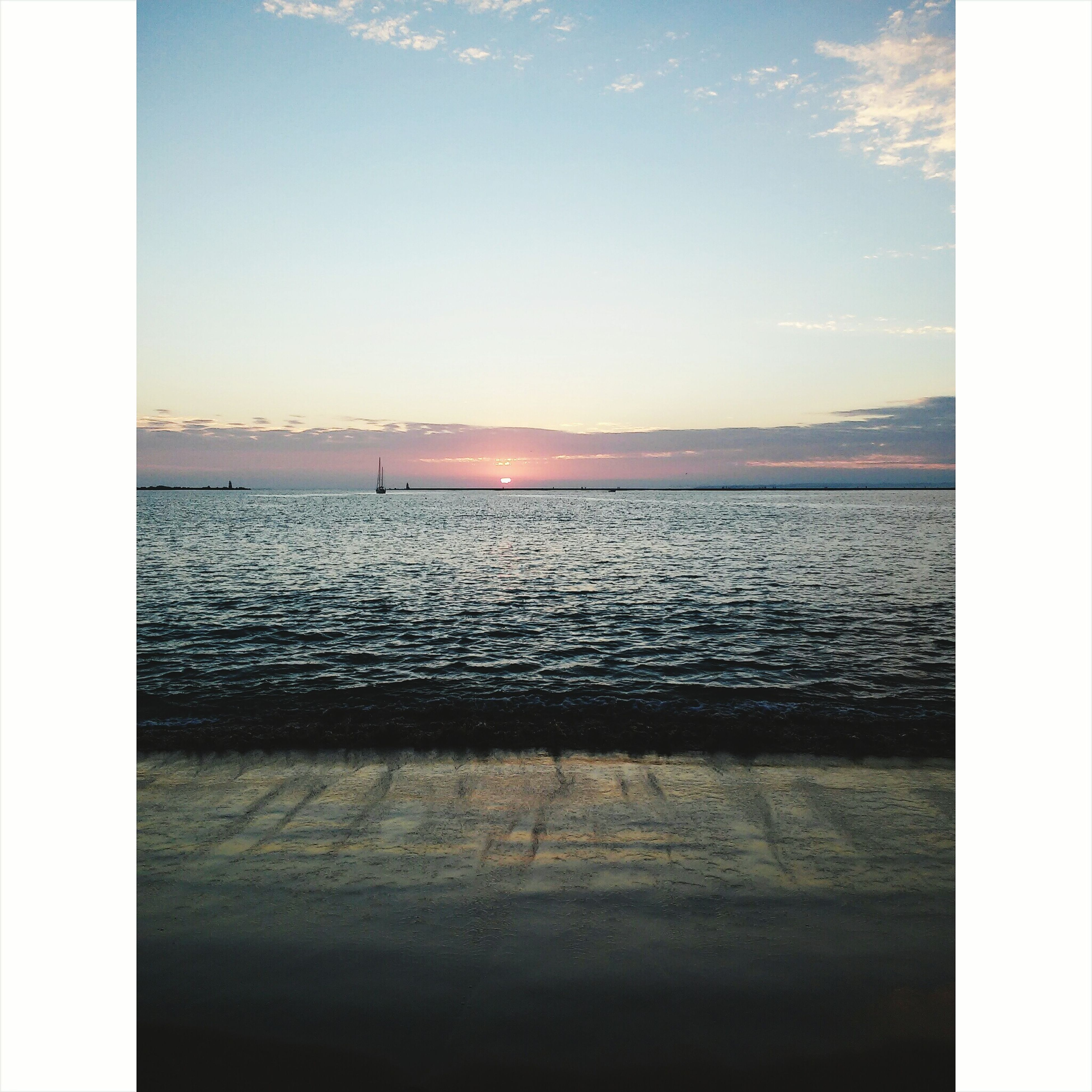 transfer print, water, auto post production filter, tranquil scene, scenics, tranquility, sea, sky, beauty in nature, sunset, nature, idyllic, horizon over water, rippled, reflection, lake, calm, silhouette, waterfront, outdoors