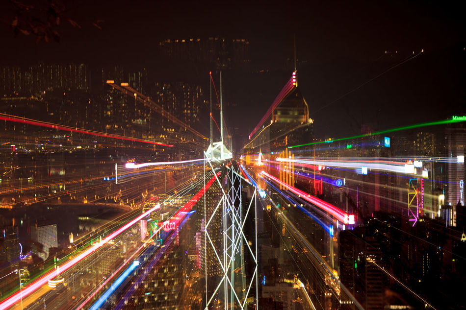 The Hong Kong skyline, with exploding zoom Architecture Building Exterior Built Structure City City Life Cityscape Eye4photography  EyeEm Best Shots Illuminated Light Trail Long Exposure Modern Motion Multi Colored Neon Night Outdoors Sky Speed Travel Travel Destinations Urban Skyline