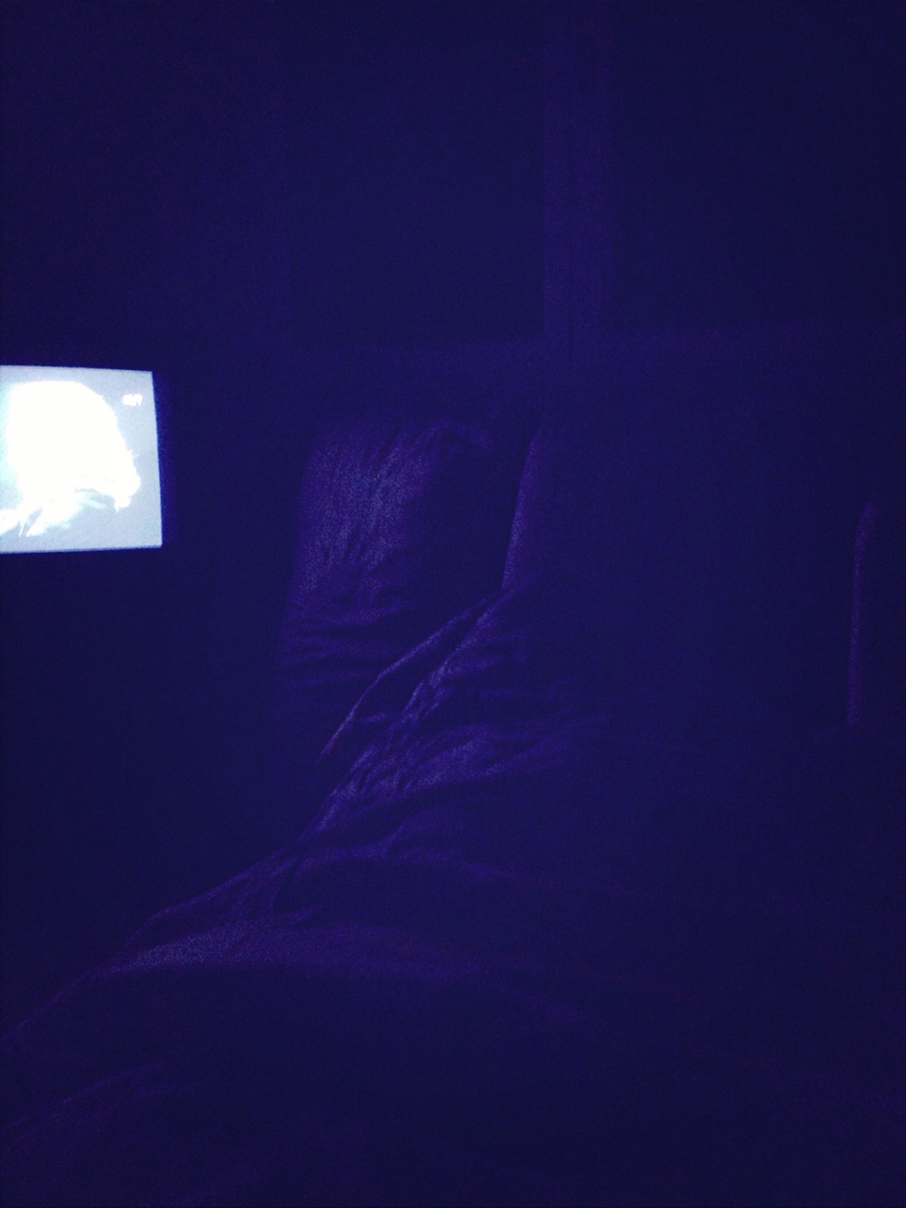 indoors, copy space, dark, blue, bed, sunlight, bedroom, home interior, window, light - natural phenomenon, no people, illuminated, shadow, absence, curtain, wall - building feature, darkroom, room, day, empty