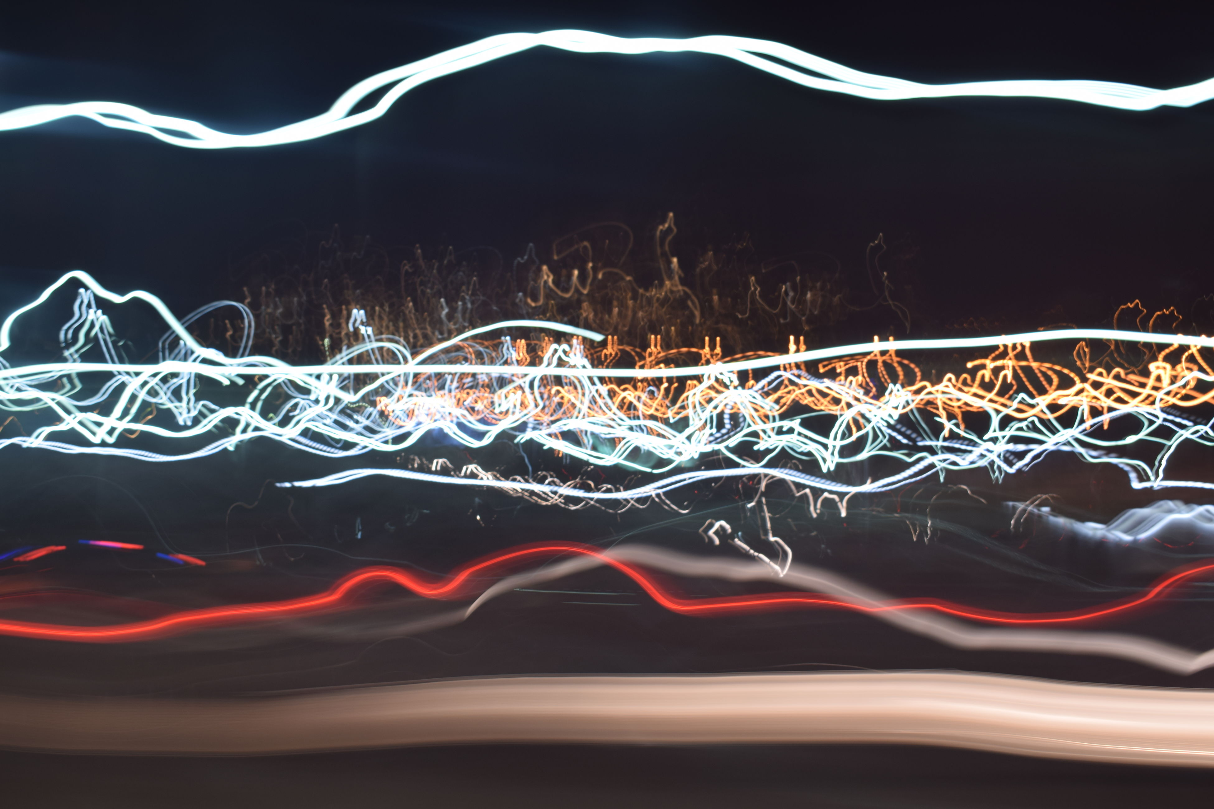 long exposure, motion, light painting, light trail, night, blurred motion, outdoors, illuminated, no people, sand, sky, beach, speed