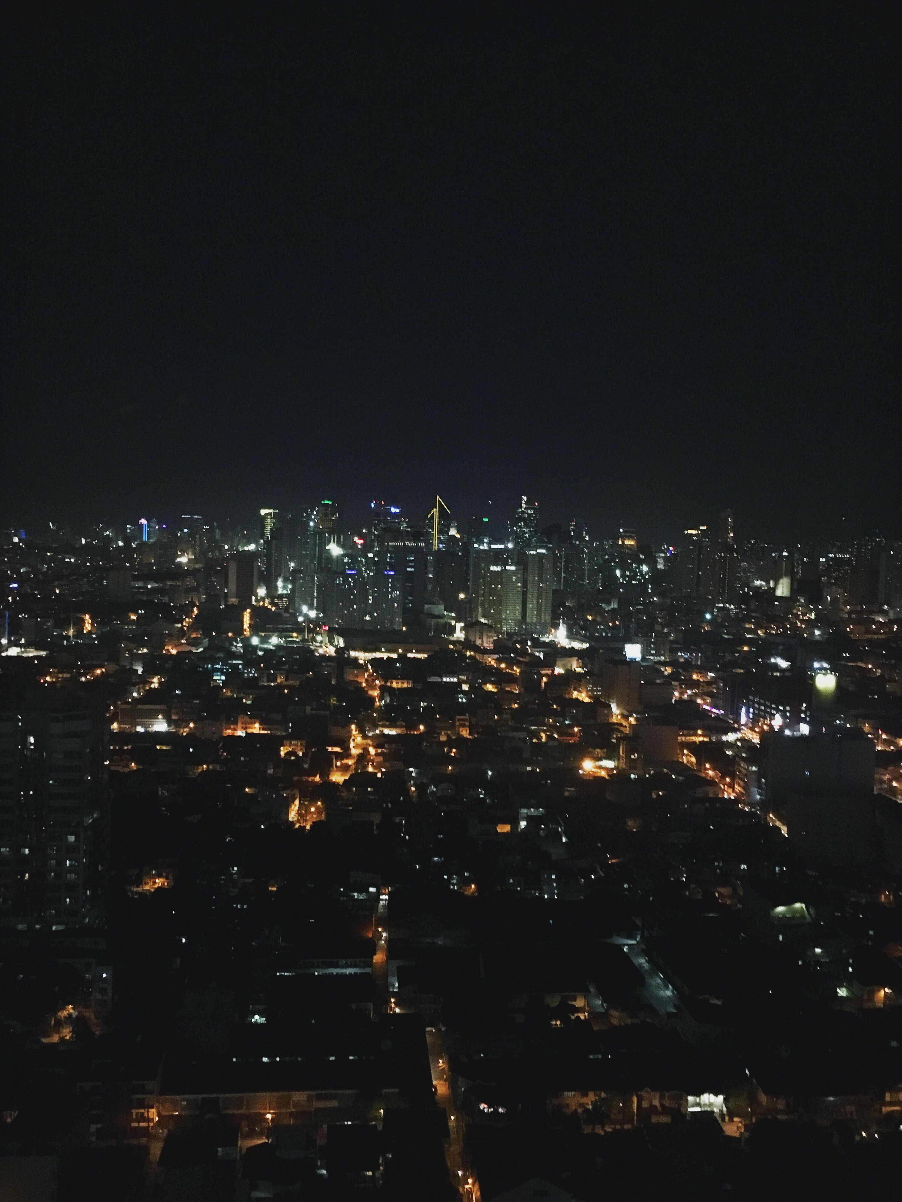 city, cityscape, night, illuminated, architecture, built structure, building exterior, crowded, skyscraper, clear sky, aerial view, urban skyline, city life, sky, tall - high, outdoors, modern, residential district, financial district, office building, no people, development, wide shot, urban scene, tall, settlement