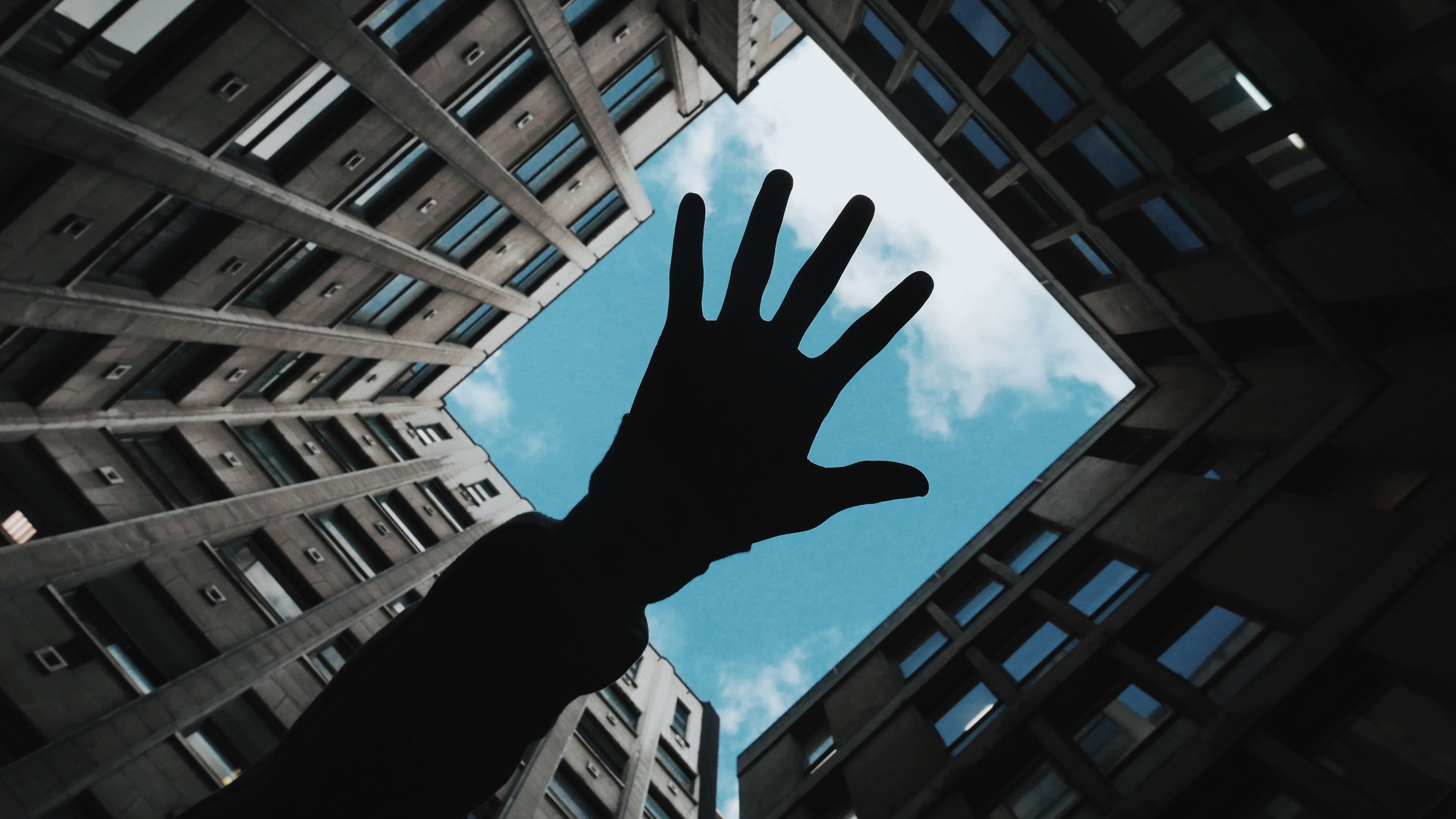 human hand, silhouette, human body part, men, gripping, sky, outdoors, people, city, adult, architecture, one person, day, adults only, one man only