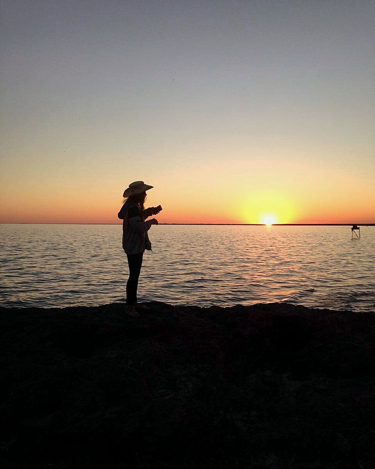 Kazakhstan lake Sunset One PersonAdult Tranquility Adults Only Beauty In Nature Reflection Beach Only Women Sea One Woman Only Silhouette Standing Sky Outdoors Discovery Night Full Length People Fishing Fisherman Fishing Time Nature Light Scenics