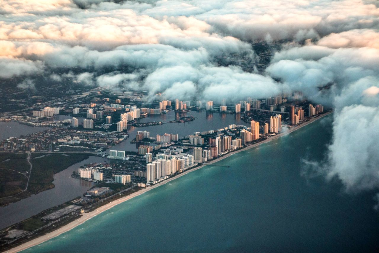 Battle Of The Cities Miami Miami Beach Florida Florida Life Building Exterior City Cityscape Cloudscape Sea Aerial View Cloud - Sky Scenics Travel Destinations Cloud Waterfront City Life