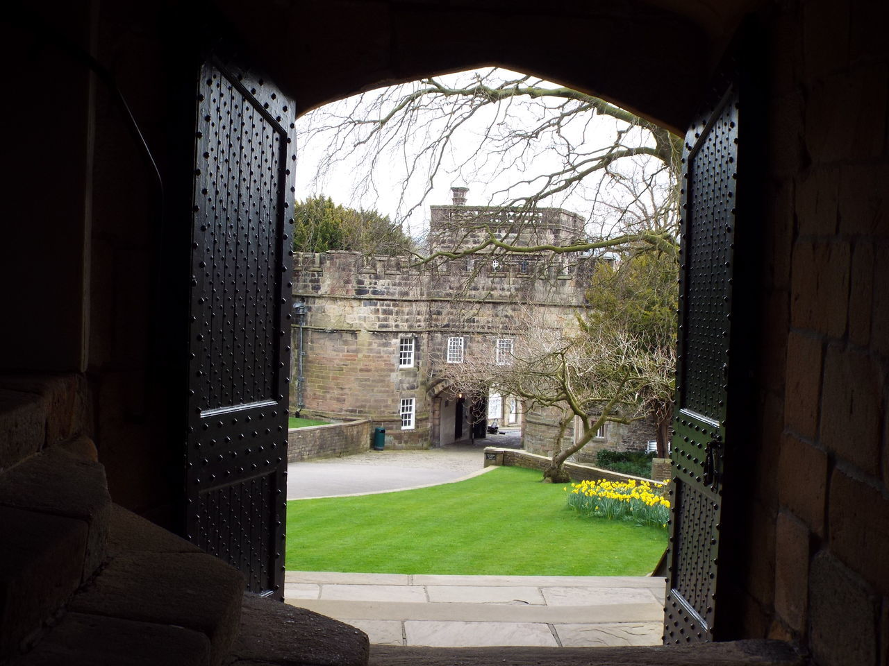 Looking through Skipton Castle's main entrance doors towards the gatehouse Medieval Castle Medieval Castle Skipton Castle Castle Entrance Entrance Main Entrance Skipton Castle Gatehouse Gatehouse