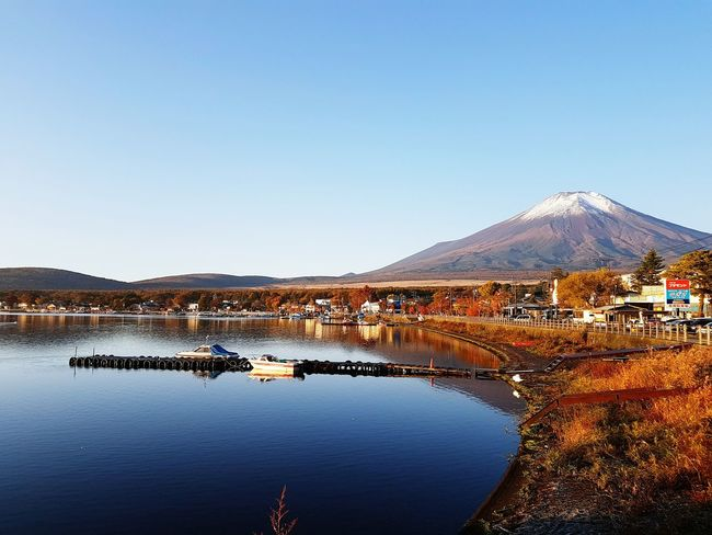 Mount Fuji bathed in sunrise Reflection Water Sky Lake Outdoors Nature Bridge - Man Made Structure Scenics No People Day