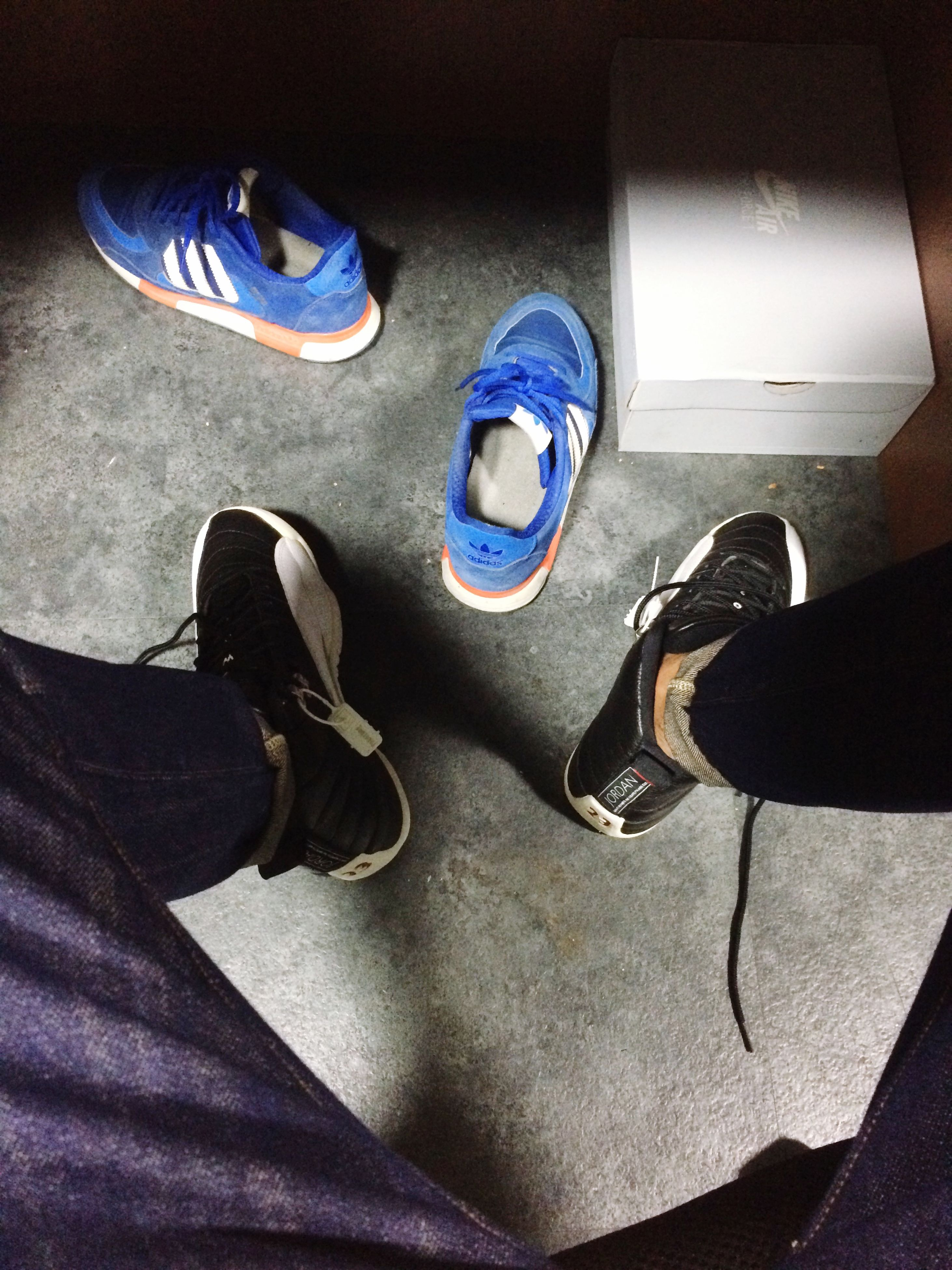 low section, shoe, person, footwear, high angle view, indoors, human foot, personal perspective, jeans, men, part of, lifestyles, leisure activity, canvas shoe, pair, unrecognizable person, standing