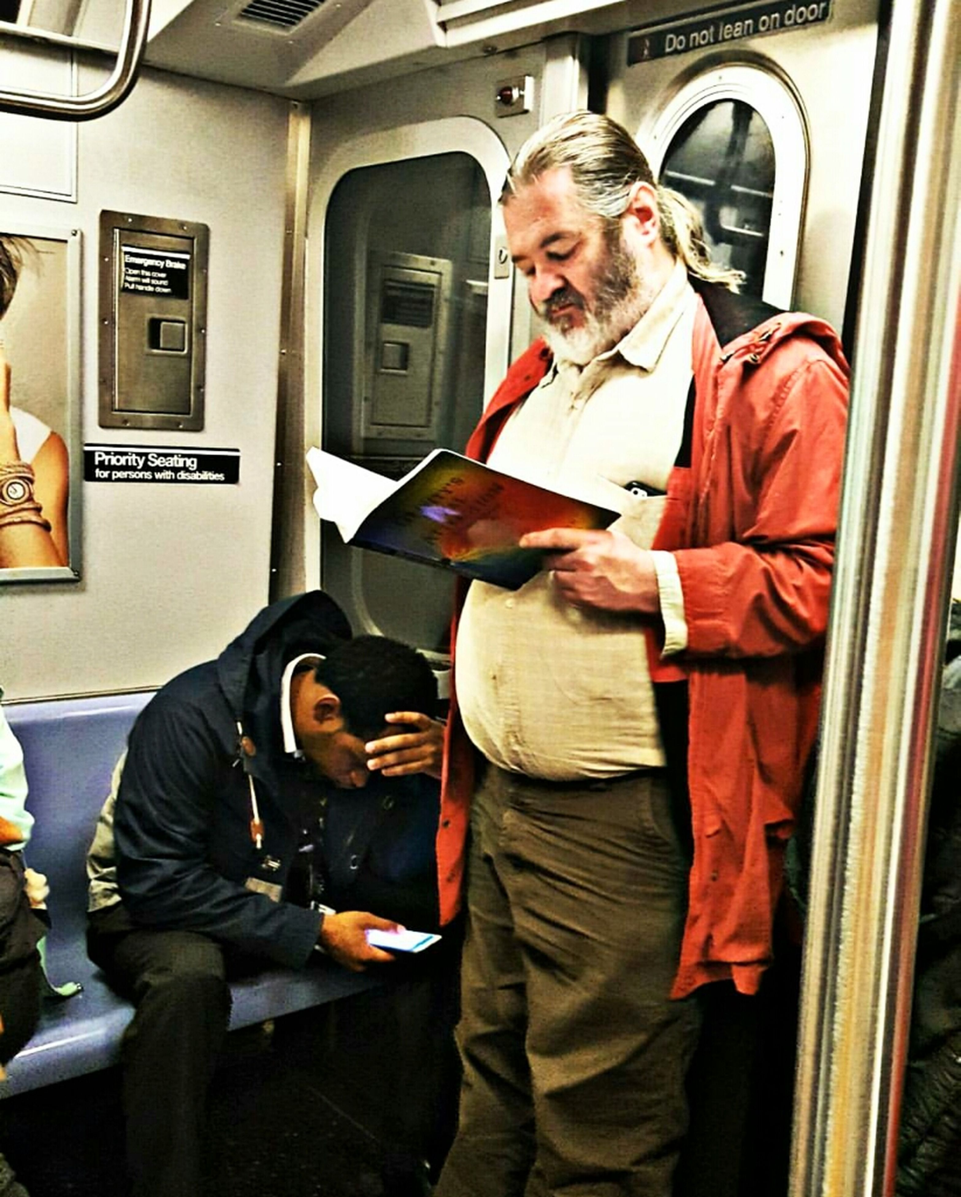 mature adult, public transportation, transportation, one mature man only, mode of transport, mature men, vehicle interior, one person, adults only, only men, subway train, people, day, indoors, one man only, adult