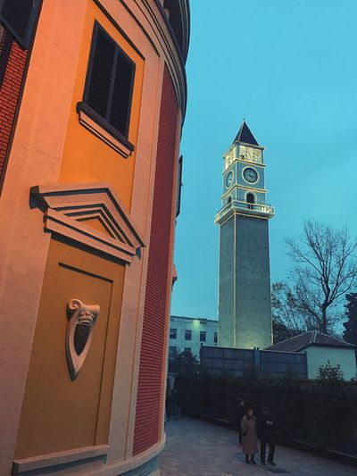Tirana center by night: clock tower and the building of the municipality. Building Exterior Architecture Outdoors Sky Clock Tower Bell Tower Sightseeing Traveling Tourism Albania Tirana Evening