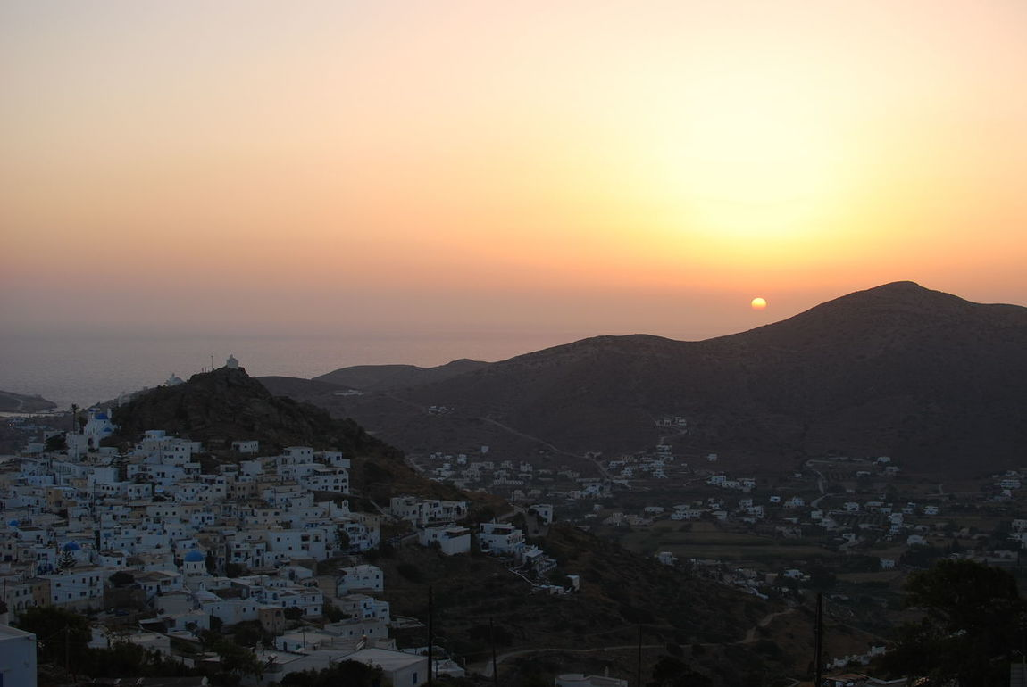 Sunset over Chora   Ios Architecture Beauty In Nature Building Exterior Built Structure Chora City Cityscape Greece Illuminated Ios Landscape Mountain Mountain Range Nature Night No People Outdoors Scenics Sea Sky Social Issues Sunset Travel Destinations Urban Skyline