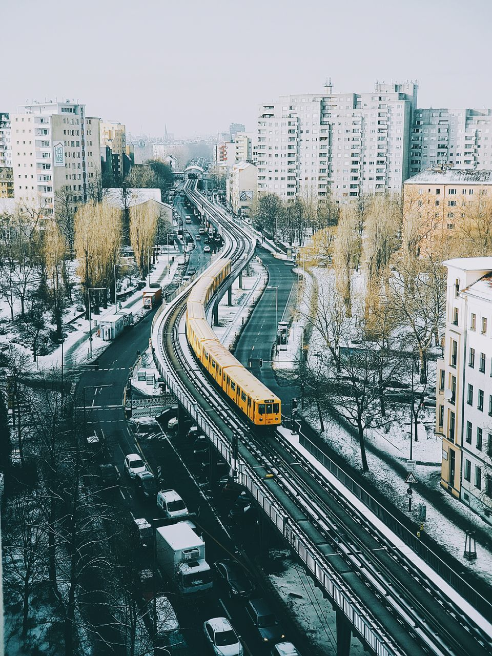 High Angle View Of Train On Bridge In City During Winter