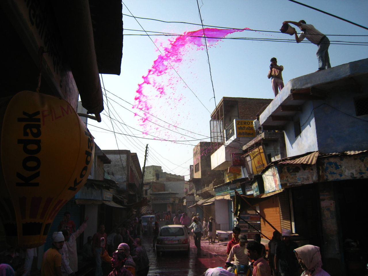 Adult Building Exterior Day Frozen Time Holi Festival Holi In India Holi Week Holiday In Liquid Men Outdoors People Pink Real India Still Finds Itself In Countryside Real People Sky Street Vrindaban