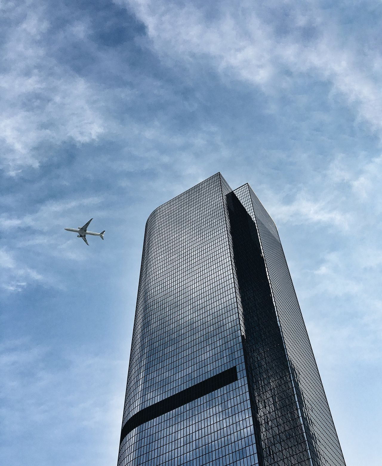 Sky Architecture Low Angle View Flying Built Structure Building Exterior Travel No People Transportation Airplane Cloud - Sky City Modern Outdoors Tall Day Skyscraper