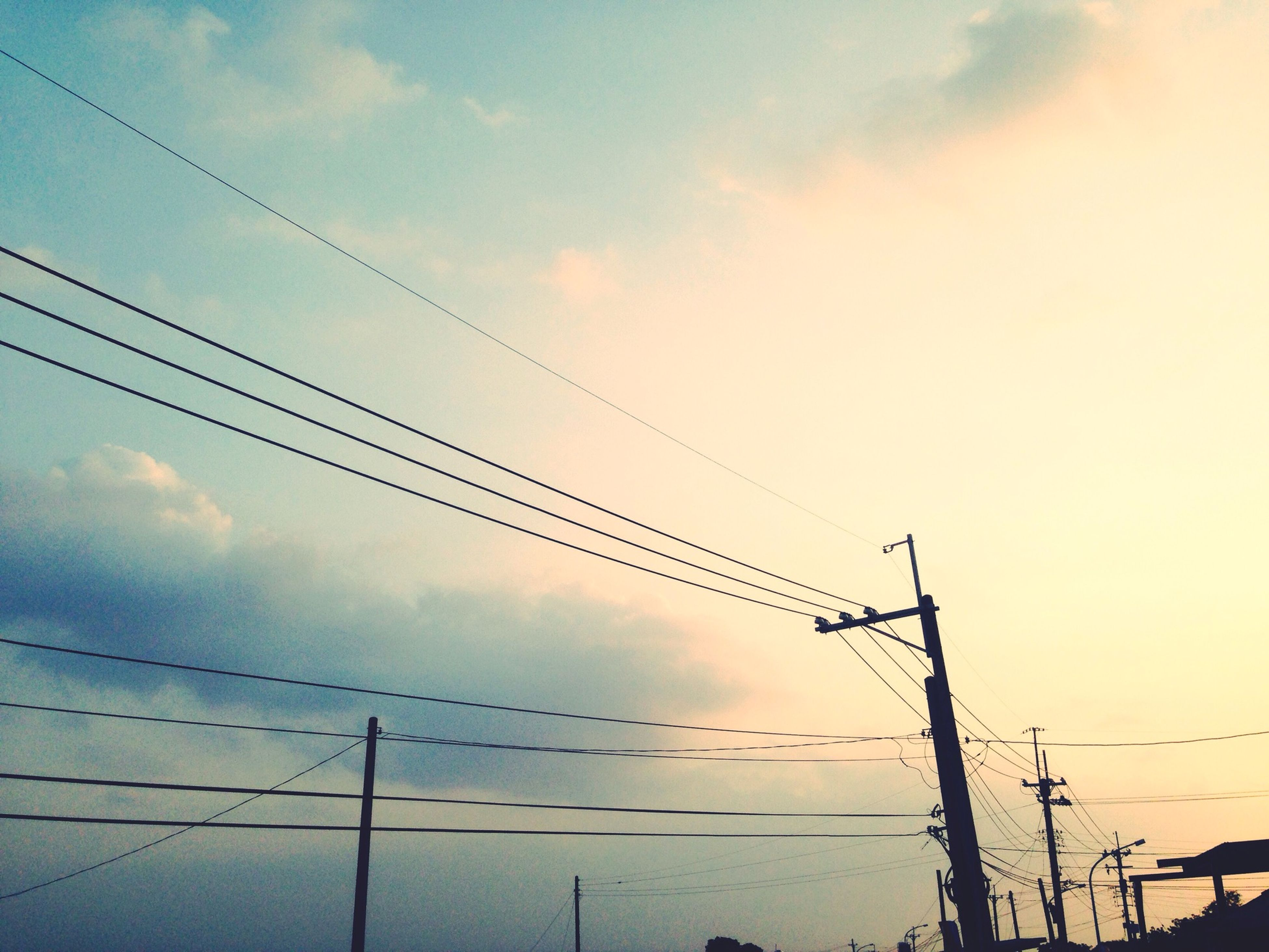 power line, low angle view, cable, sky, electricity pylon, power supply, electricity, connection, cloud - sky, fuel and power generation, power cable, technology, silhouette, cloudy, cloud, bird, outdoors, no people, pole, animal themes