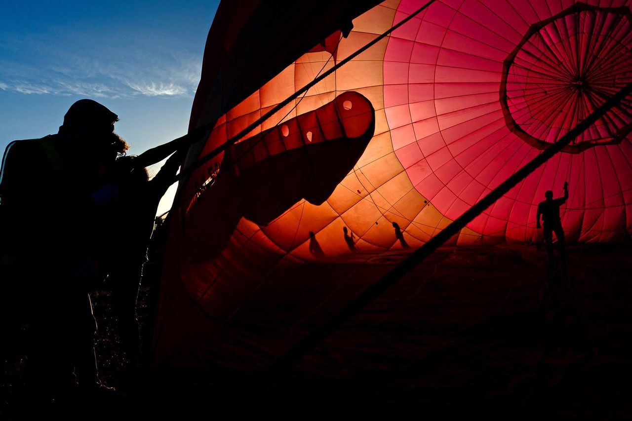 Hot Air Balloon Sky Adventure Red Travel Destinations Tourism Air Vehicle Silhouette Real People Adults Only Vacations One Person Outdoors Ballooning Festival People Only Men Adult Day