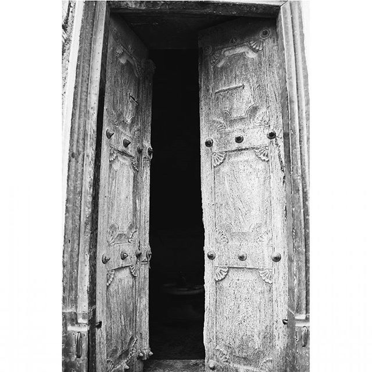 The door less opened... Door Ancient Vintage Architecture Portal Timetravel Travelingram Vintagehome Ancientarchitecture Vscocam Travel Traditional Newworld Instaart Nikond5300 Nikoninsta Architecturephotography Oldindian Historic Symbolism Blackandwhite Monochrome Wood Templevisit Indian pattern design texture raw geometric