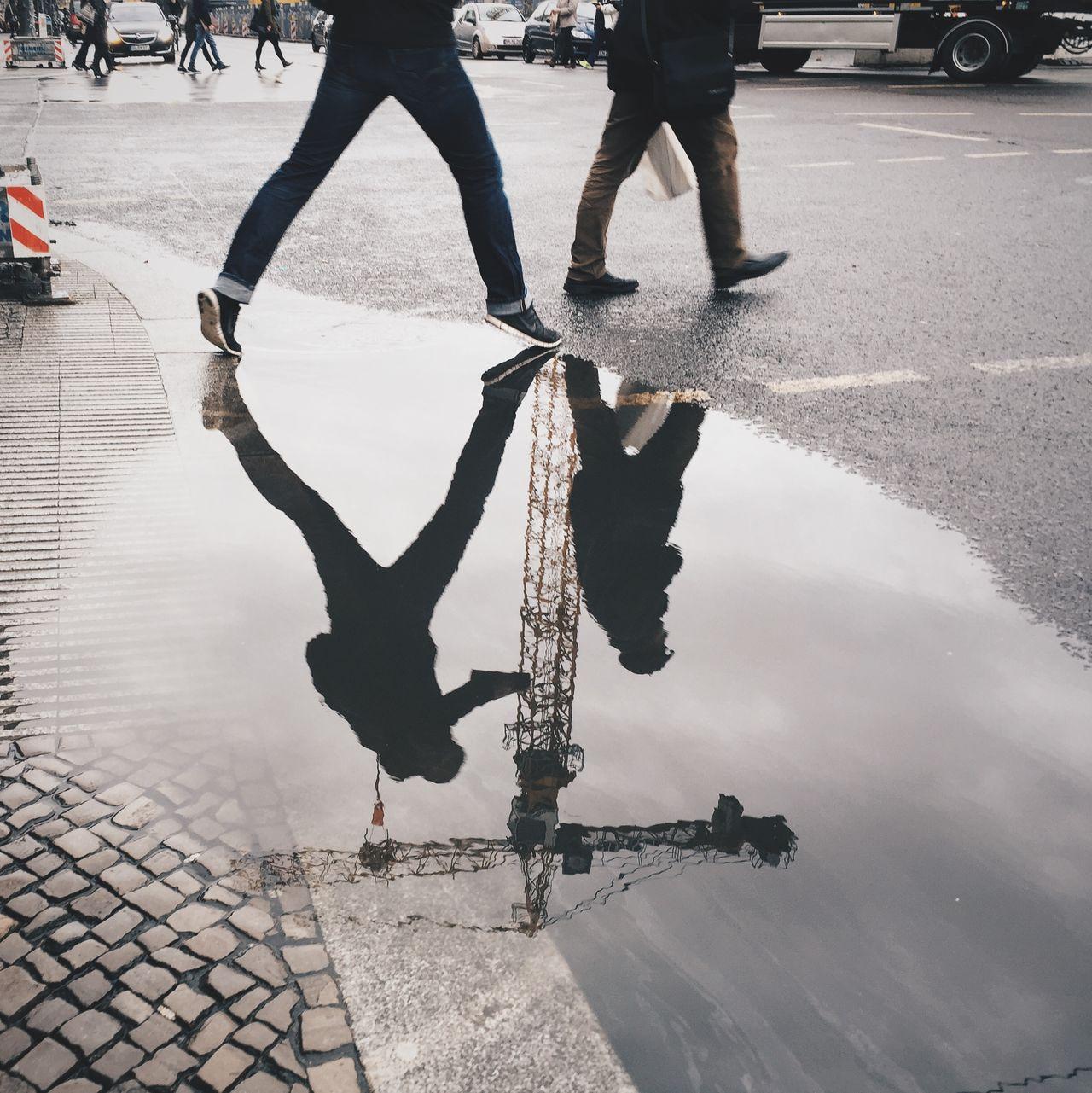 Henri Cartier Bresson meets Berlin street life Berlin City Life Day Go To Work Human Foot Leisure Activity Lifestyles Low Section Men Mirror Morning Outdoors Person Rain Road Shoe Sidewalk Standing Street Streetphotography Urban Walking Wet Wetter Work