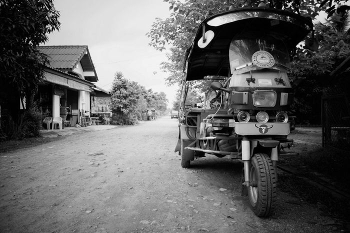 Black And White Friday Transportation Tree Outdoors Land Vehicle Street Built Structure Architecture Day Building Exterior Road No People Nature Sky Laos