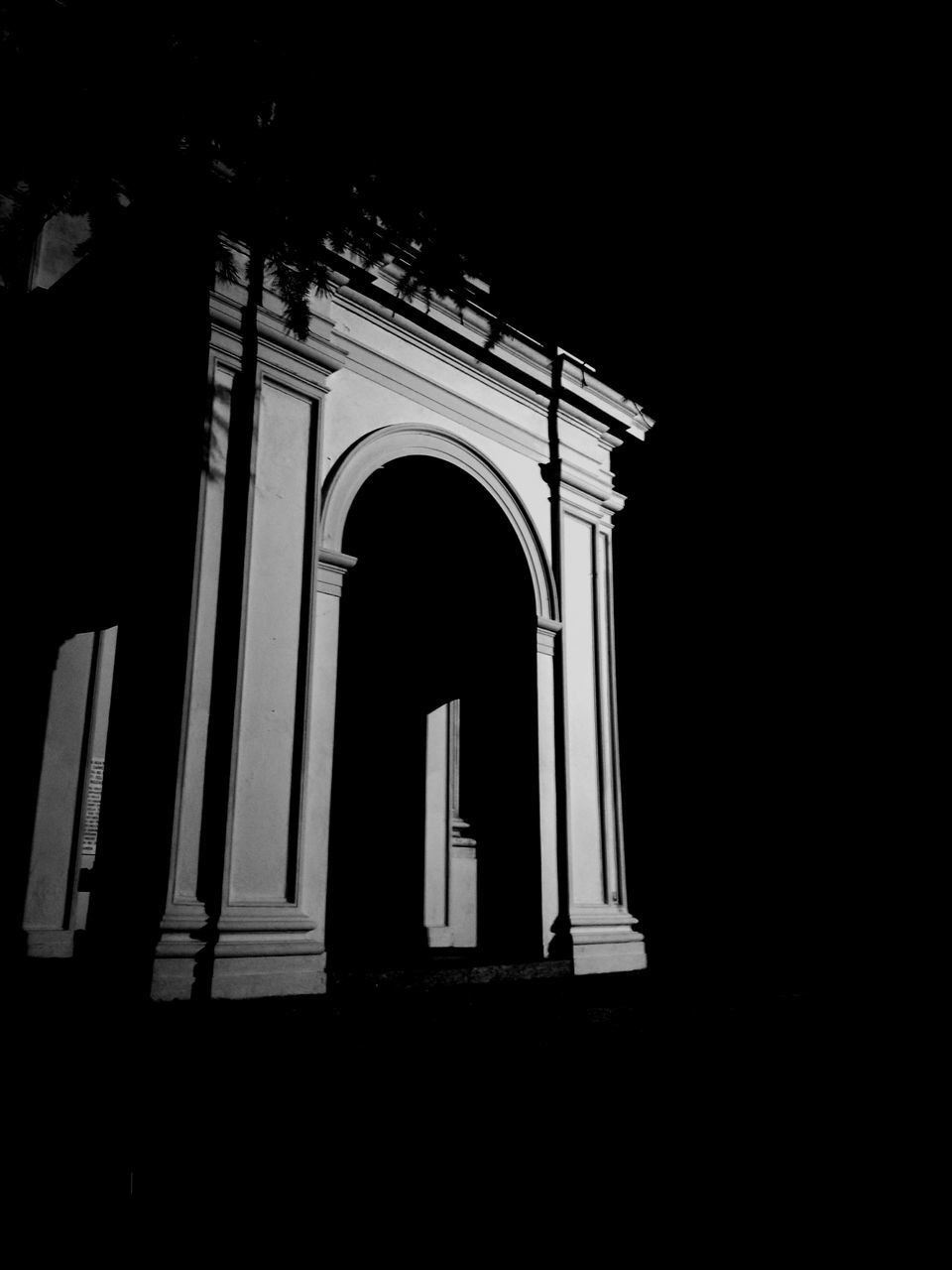 low angle view, arch, architecture, religion, built structure, window, spirituality, no people, night, outdoors
