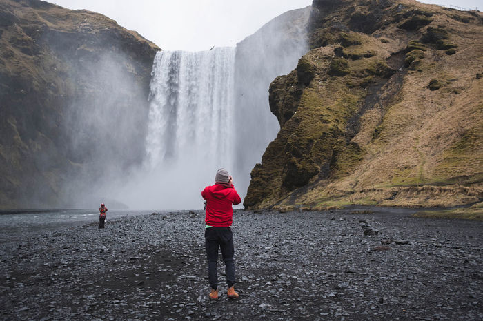 Iceland Nature Rain Travel Yellow Jacket Red Jacket Skogafoss Waterfall