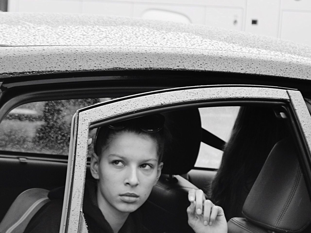 What happens The Portraitist - 2016 EyeEm Awards Model Woman Portrait Of A Woman Woman Portrait Women Who Inspire You Open Edit Portrait Peoplephotography Car People Photography Black And White The Week On EyeEm