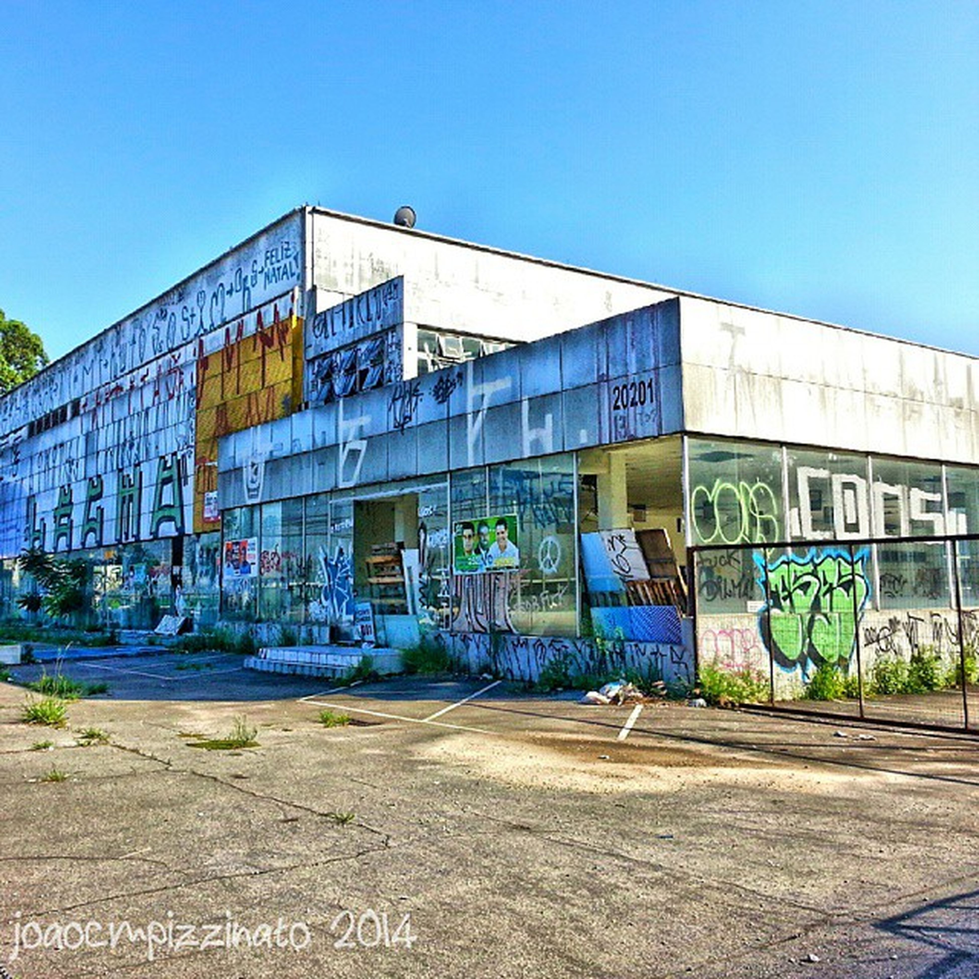 architecture, built structure, graffiti, building exterior, clear sky, blue, text, art, western script, creativity, transportation, art and craft, day, sunlight, street, outdoors, building, city, sky, road