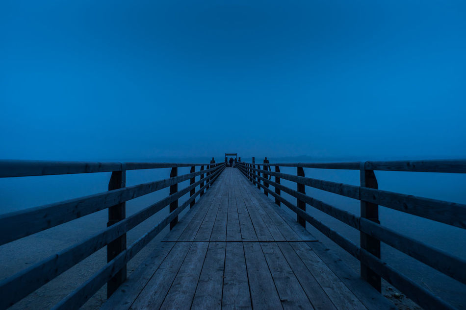 Fishermen Beauty In Nature Boardwalk Clear Sky Day Elevated Walkway Fishermen Fishing Horizon Over Water Munich Outback Nature Night Fire No People Outdoors Pier Railing Sea Sky Water Wörthsee