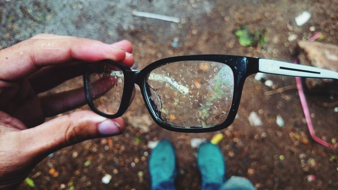 Reflection Eyeglasses  Close-up Sunglasses Human Hand One Person Day Outdoors Eyewear Human Body Part Eyesight People Vision Adult Winter Water Drops Water Drops Raining Rain