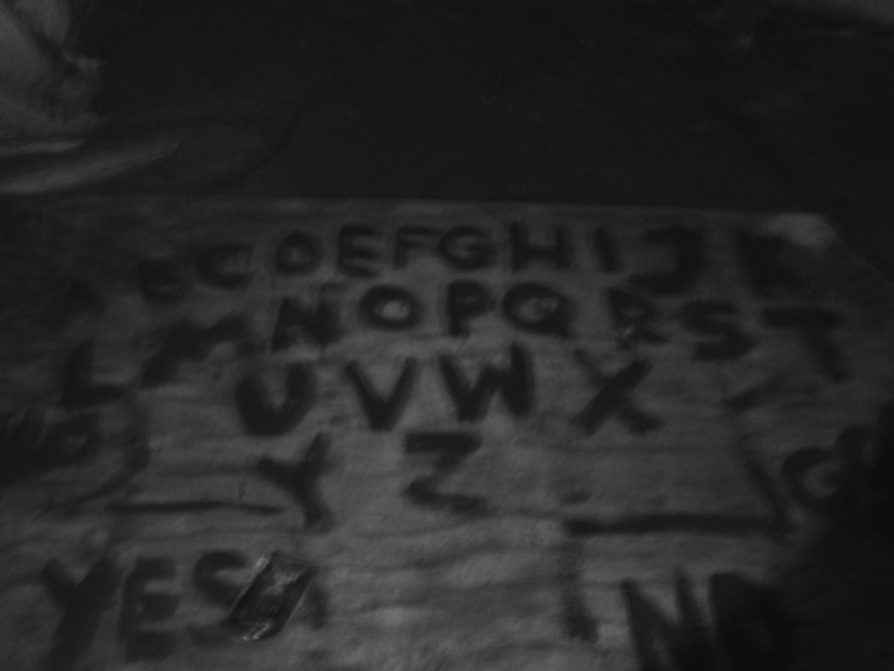 Found an ouiji board in an abandoned WW2 hideout, took a photo of it. Abandoned Close-up Communication Haunted Indoors  Ouija Board  Spirituality Text Wood