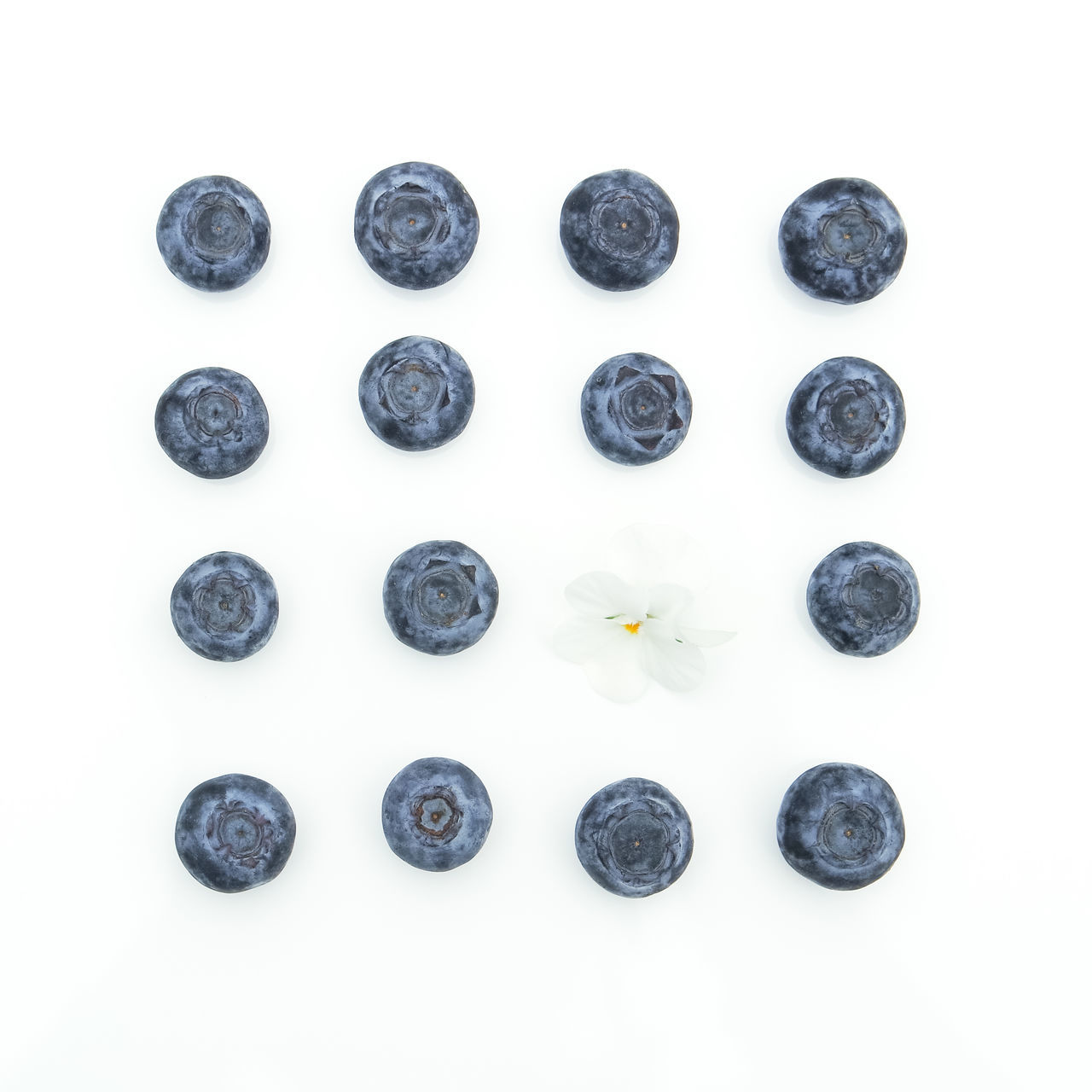 High Angle View Of Blueberries Against White Background