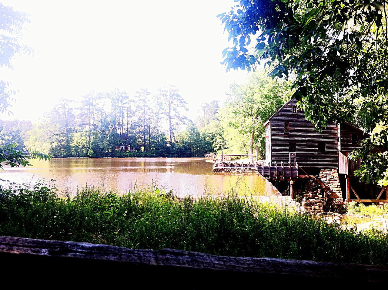 A Lake and A Watermill, North Carolina Outdoors Nature Tree Building Exterior Built Structure Lake No People Day Brightness Vs. Darkness Sunny Day Light And Shadow Sun And Fog Trees In The Fog Tranquility Peace And Quiet Old Buildings Architecture Calm Waters Hidden Oasis