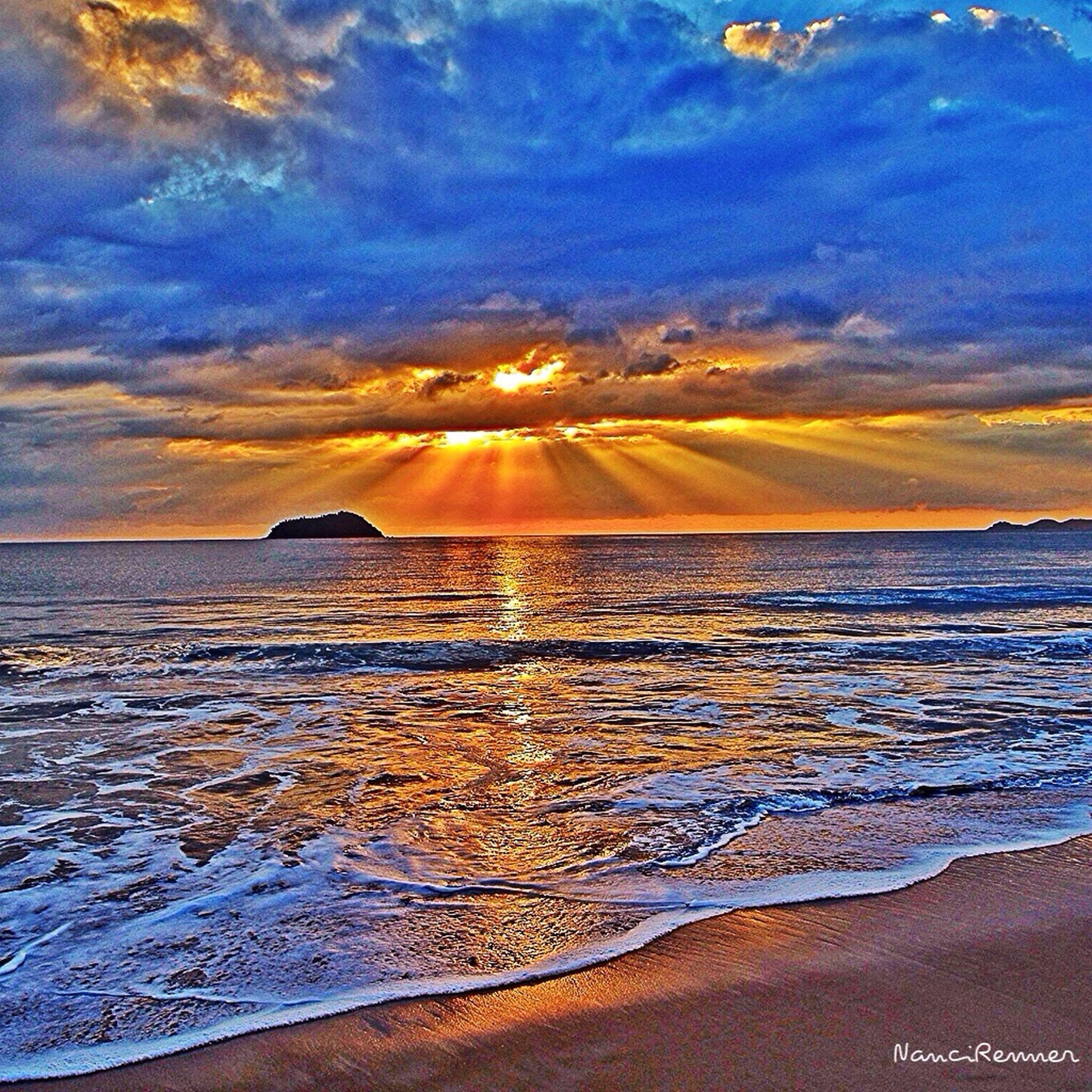 scenics, sea, beauty in nature, tranquil scene, sunset, tranquility, water, sky, beach, nature, idyllic, cloud - sky, horizon over water, orange color, mountain, shore, sand, wave, cloud, non-urban scene