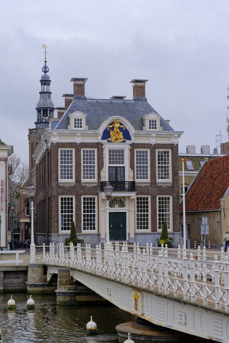 town hall in Harlingen, Netherlands Architecture Bridge Building Exterior Built Structure Church City City Hall Clouds Clouds And Sky Day Flag History Netherlands Netherlands ❤ No People Noorderhaven Outdoors Politics And Government Sculpture Sky Stadhuis Statue Town Hall Travel Destinations Water