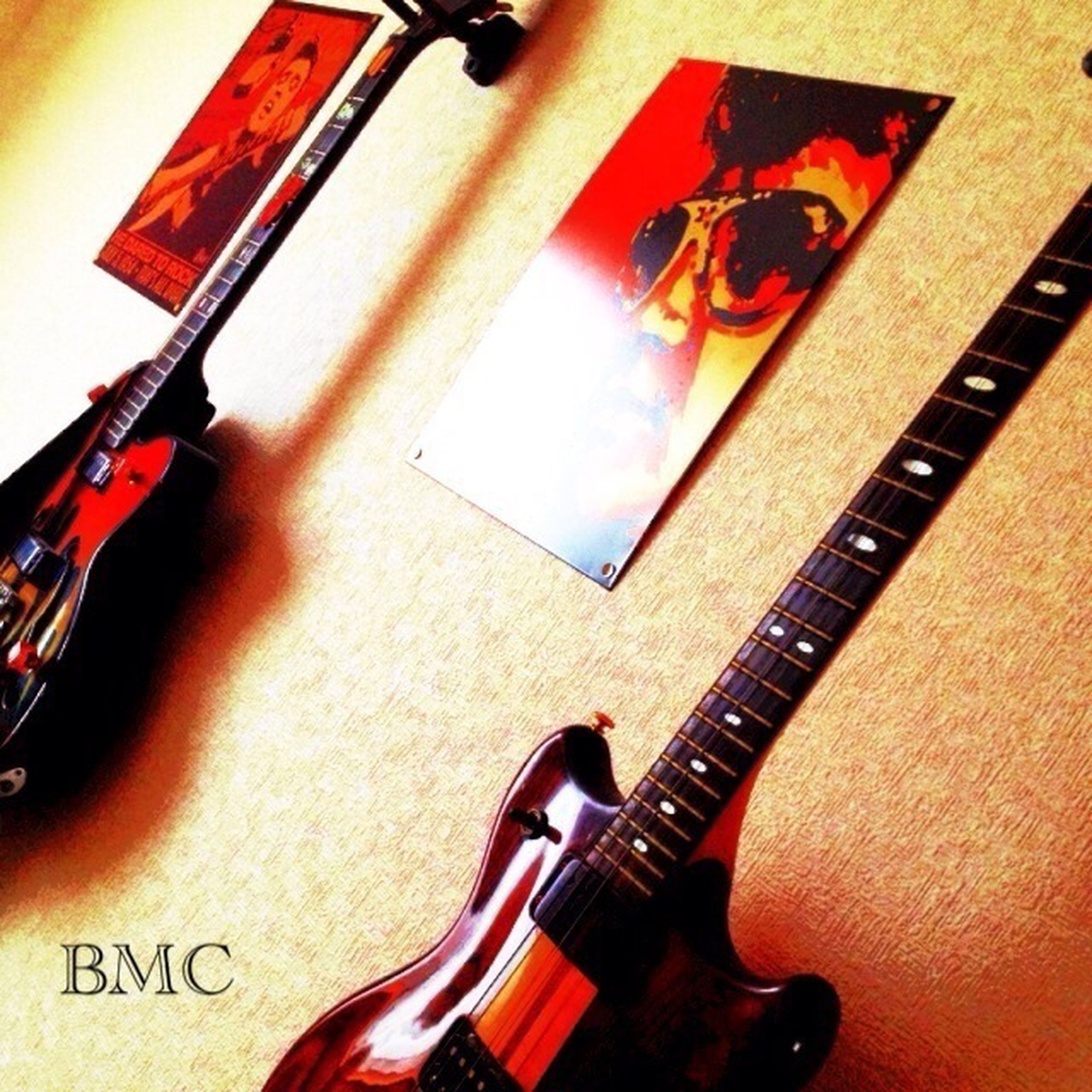 indoors, still life, table, high angle view, music, technology, arts culture and entertainment, musical instrument, close-up, communication, no people, home interior, musical equipment, wood - material, guitar, book, paper, wireless technology, education, connection