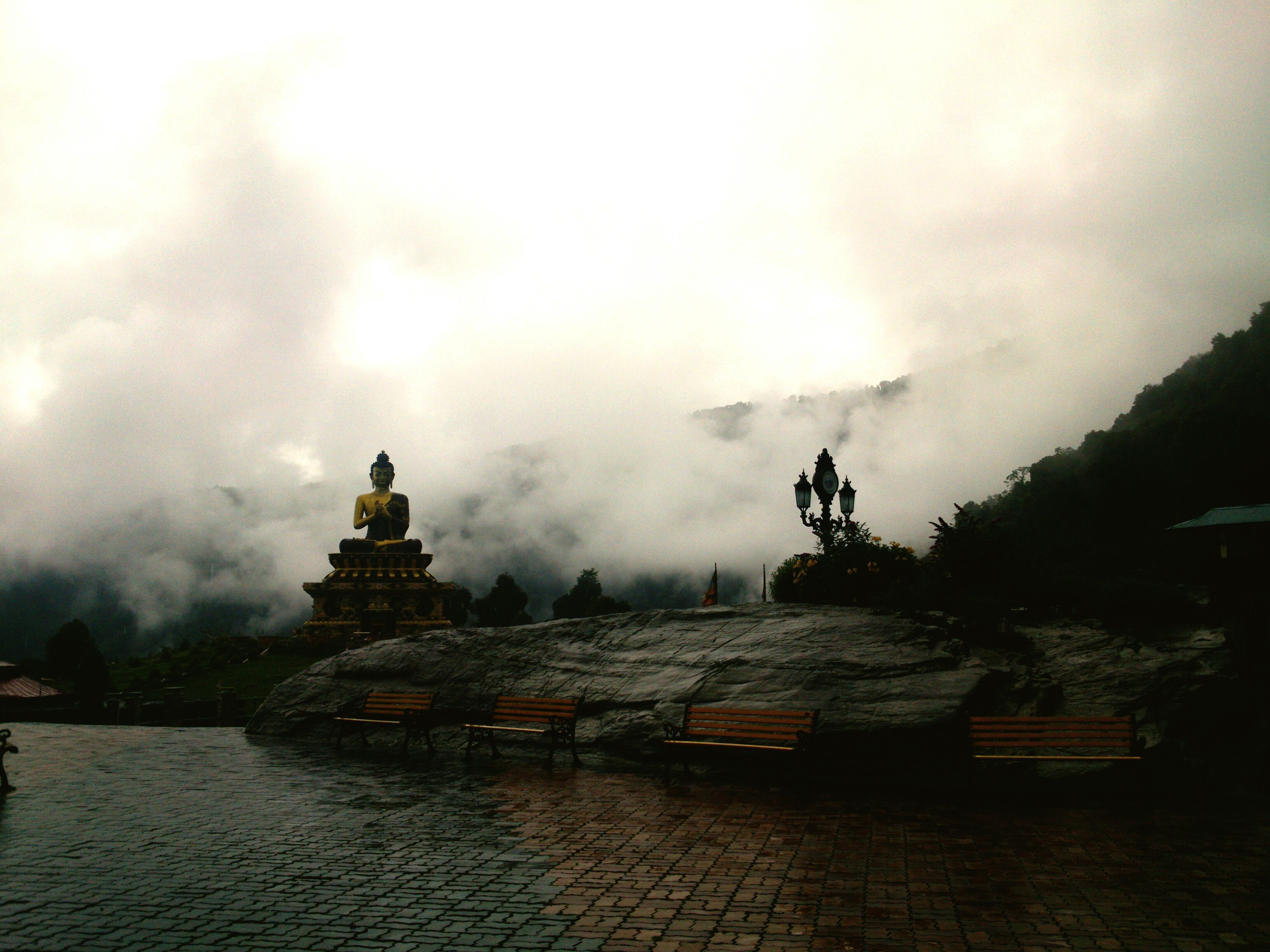 architecture, built structure, sky, cloud - sky, water, building exterior, cloudy, waterfront, weather, history, dusk, overcast, sunset, temple - building, nature, tranquility, the past, river, old, cloud