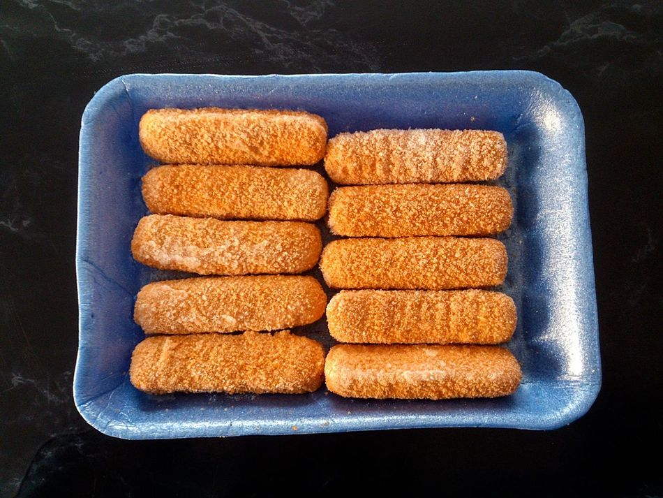 A Packet of Frozen Fish Fingers Black Background COD Convenience Food Delicious Food Fish Fish Fingers Fish Sticks Food Food Porn Freshness Frozen Food Haddock Healthy Eating High Angle View Indoors  No People Nutrition Nutritious Seafood Uncooked Whitefish