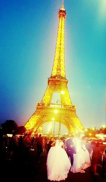 Illuminated Large Group Of People Travel Destinations Tourism Low Angle View Clear Sky International Landmark City Life Widding Battle Of The Cities People And Places People Of EyeEm Famous Place Eiffel Tower Paris ❤ Amour ❤ France 🇫🇷 I Love My City I Adore You  Photography City Life Capital Cities  Lifestyles Crowd Outdoors