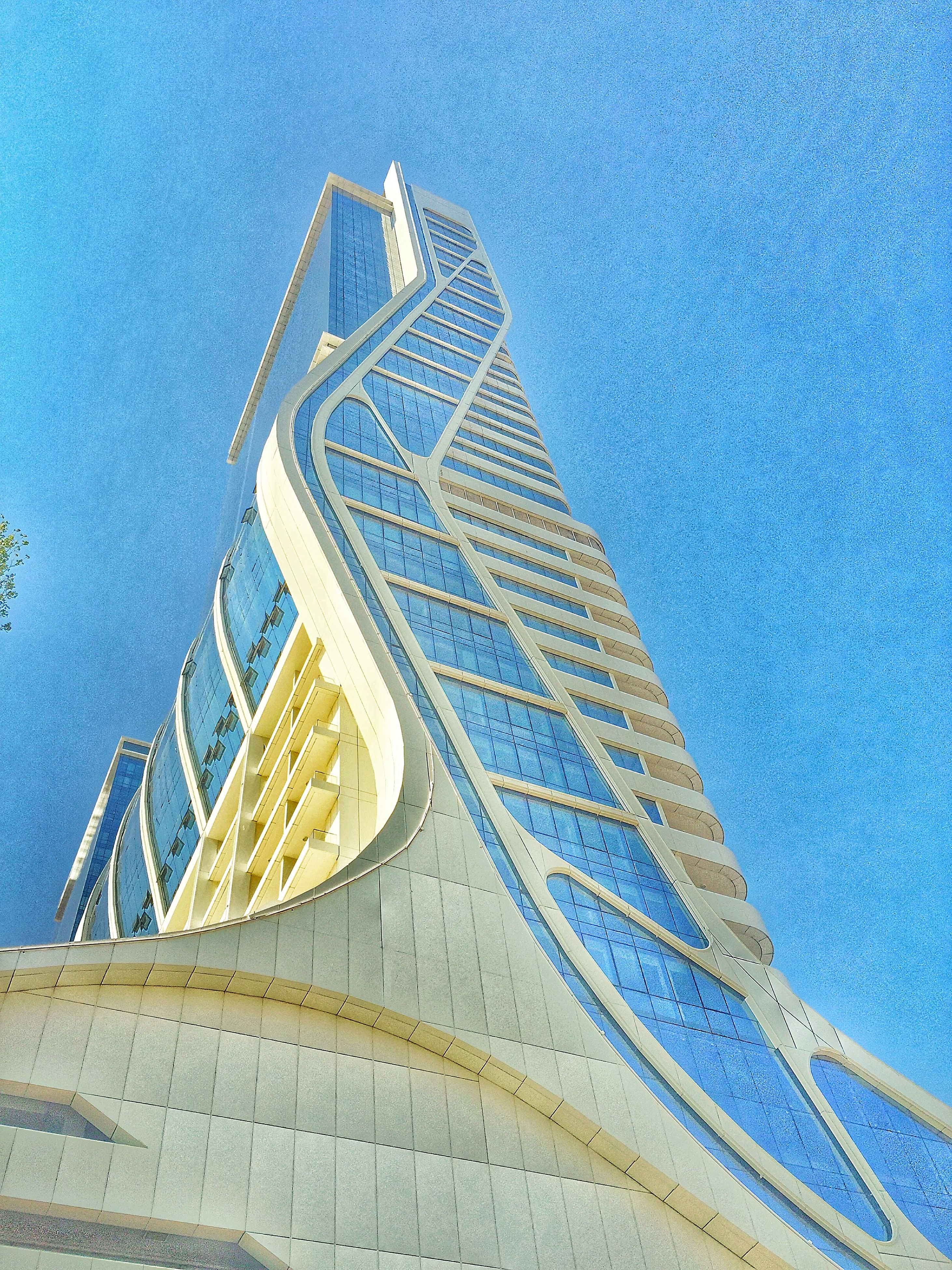 blue, low angle view, built structure, pattern, architecture, white color, building exterior, day, sunlight, outdoors, clear sky, no people, copy space, sky, shadow, design, turquoise colored, high angle view, art, white