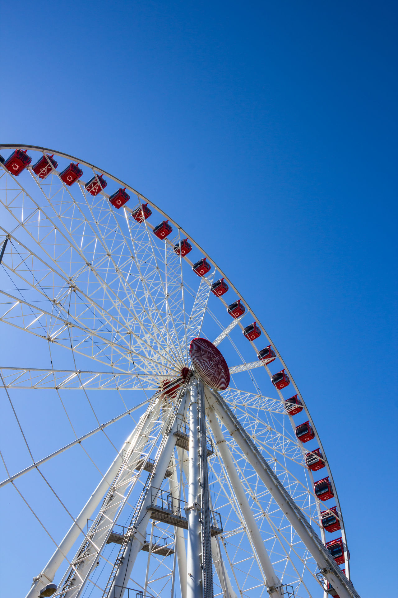 Jesolo, Italy, July 19 2016: ferris wheel on blue sky background. Amusement  Background BIG Blue Bottom Carnival Carousel Circle Color Colorful Day Enjoy Entertainment Fair Fairground Ferris Festival Fun High Holiday Joy Leisure Outdoor Park Red