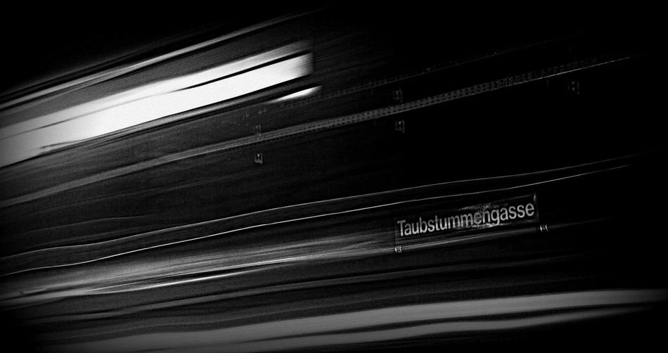 Woman Black And White Metro Metrostation Austria Viennacity Vienna, Austria People Travel Destinations Movement Arts Culture And Entertainment Close-up Text No People Black Background Indoors  Day capturing motion