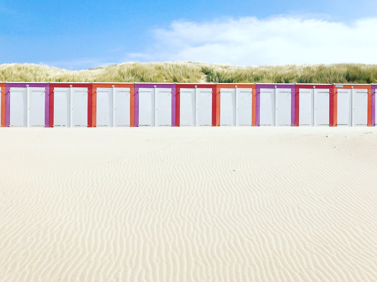 Wooden huts at the beach in Oostkapelle, Netherlands Beach Sand Oostkapelle Zeeland  Netherlands Summer Copy Space Text Space Travel Destinations Summertime Tourism