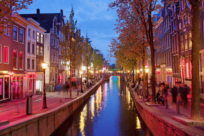 Red Light District by night in Old Town of Amsterdam in Holland, the Netherlands Amsterdam Amsterdam Canal City City Break Houses Night Lights Nightphotography Old Town Red Red Light District Tourist Attraction  Architecture Buildings Canal City Lights District Dusk Europe Evening Holland Night Night View Nightlife Red Lights Travel Destinations