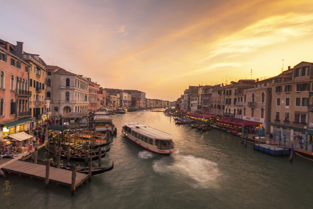 Sunset at Grand Canal, Venice. View from Ponte di Rialto Adriatic Architectural Feature Architecture Boat; Bridge; Summer; Sunset; Highway; Sun; The Road To The Island; Sunlight; Vladivostok; Cityscape; Perspective; Columns; The Sea; The Eastern Bosphorus Strait; A Beautiful Sunset; Summer Landscape; Bright Sunshine City Europe Gondola Gondolier Grand Canal River Sunset Taking Photos Tourism; Tourist Vacation Venetian; Venice, Italy