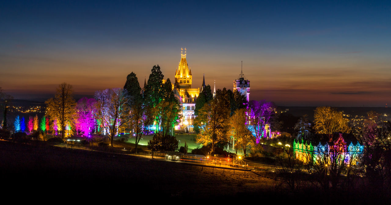 Shot in Bonn, Germany. Wolfgang Flammersfeld created a stunning light installation to drawn Drachenburg castle in multi colors. Architecture Art Blue Castle Cityscape Design Drachenburg Drachenfels Drachenfels Siebengebirge History Illuminated Landscape Lighting Multi Colored Night NRW Red Scenics Sky Sunset Sunset_collection Tower Travel Destinations Vacations Wolfgang Flammersfeld