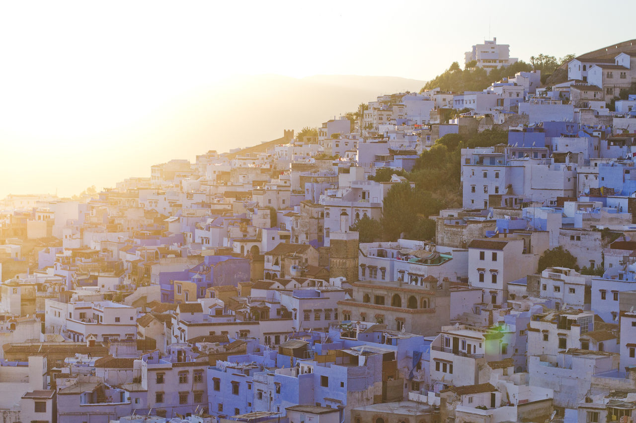 Architecture Building Exterior Built Structure Business Finance And Industry City Cityscape Day House Morocco Mountain No People Outdoors Residential Building Sky Sunset Town Travel Destinations
