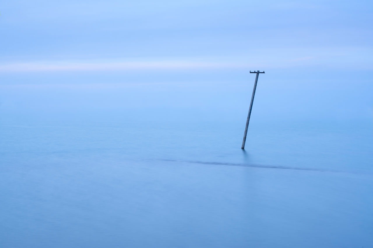 Beauty In Nature Blue Blue Wave Cold Temperature Horizon Over Water Lake Lighting Equipment Minimal Minimalism Nature Non-urban Scene Pole Scenics Tranquil Scene Tranquility Water